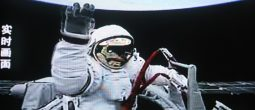 This TV screen shot from CCTV (China Central Television) shows Chinese taikonaut (astronaut) Zhai Zhigang waving to a camera while walking out of the orbital module (capsule) of the Shenzhou VII manned spacecraft for Chinas first spacewalk, Saturday, 27 September 2008.  China Saturday launched its first spacewalk during the Shenzhou VII manned spaceflight mission. Astronaut Zhai Zhigang wearing Chinese-made space suit walked out of the orbital module around 16:43 pm Beijing Time for the spacewalk for about 20 minutes.